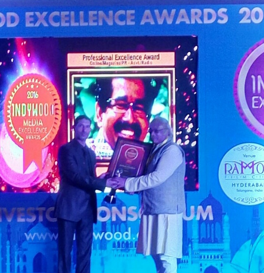 receiving-the-indywood-media-excellence-award
