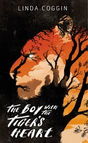 Book cover Text: Linda Coggin The Boy with the Tiger's Heart Image: Silhouette of a tiger's face. In the details of the face, silhouettes of three children and a bear and black trees