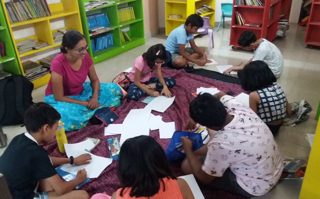 Children writing during a workshop
