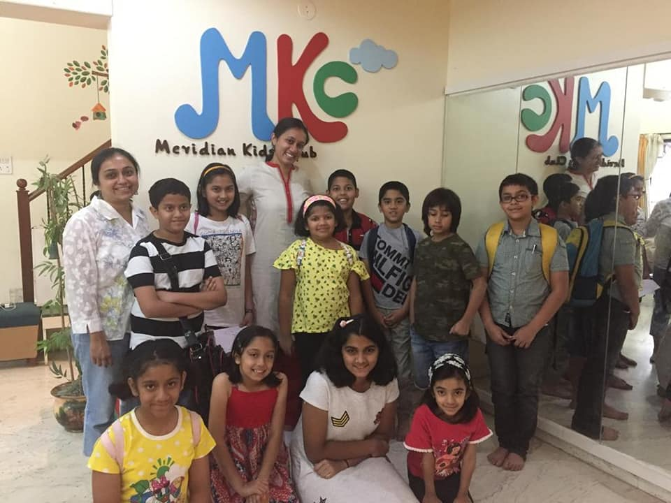 Varsha Seshan with children at Meridian Kids Club