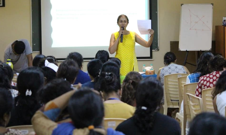 Varsha Seshan facing a group of teachers
