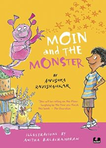 Text: Moin and the Monster by Anushka Ravishankar 'You will be rolling on the floor laughing by the time you finish this book' - The Guardian Illustrations by Anitha Balachandran Image: A pink monster with two horns standing on a pile of gifts, looking at a smiling boy standing with his arms akimbo