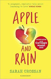 'A poignant, realistic tale about learning to love' SUNDAY TIMES APPLE AND RAIN SARAH CROSSAN BLOOMSBURY SHORTLISTED CILIP CARNEGIE MEDAL 2015 Image of a red and green apple sliced in half by lightning