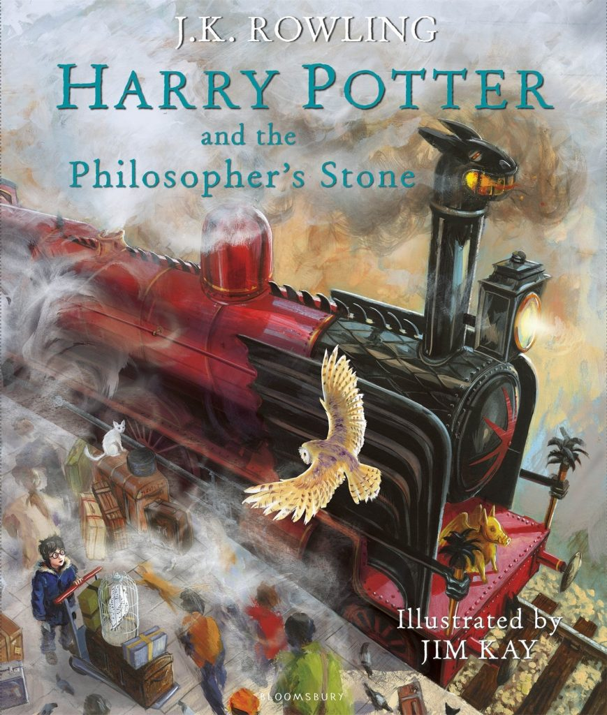 J.K. ROWLING HARRY POTTER and the hilosopher's Stone Image description - Steaming red and engine with a dragon head top drawing in at a platform. White owl in the foreground swooping down Black haired boy looking up at it amongst all the others on the platform