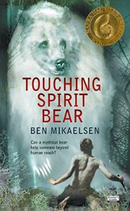 Book cover  Touching Spirit Bear  Ben Mikaelsen Can a mythical bear help someone beyond human reach? Back of a boy in the foreground, huge white bear facing the reader