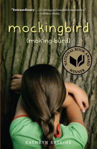 """Extraordinary...[A] moving and insightful masterpiece."" - Publishers Weekly mockingbird National Book Award Winner Image description - The back of a girl's head. She is resting her folded arms on the bark of a tree, and her face is buried in her arms."