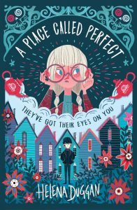 Text: A Place Called Perfect They've got their eyes on you Helena Duggan Image: In the centre, the face of a girl looking worried/angry. She is holding the rim of of her very large reddish glasses. In the bottom half, a boy in a black jacket in front of tall rooved houses. Flowers in the foreground.