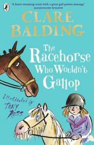 Text: 'A heart-warming story with a great girl-power message' JACQUELINE WILSON CLARE BALDING The Racehorse Who Wouldn't Gallop Illustrated by Tony Ross Image: The head of a brown horse (bridled), a pony looking up at it. A girl in a helmet sitting on the pony