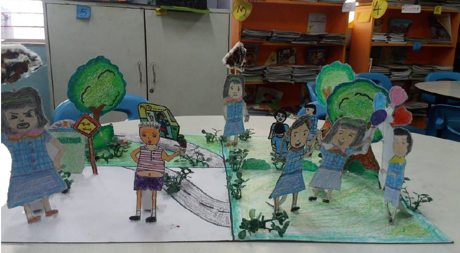 A pop up display of children based on the story A Cloud of Trash
