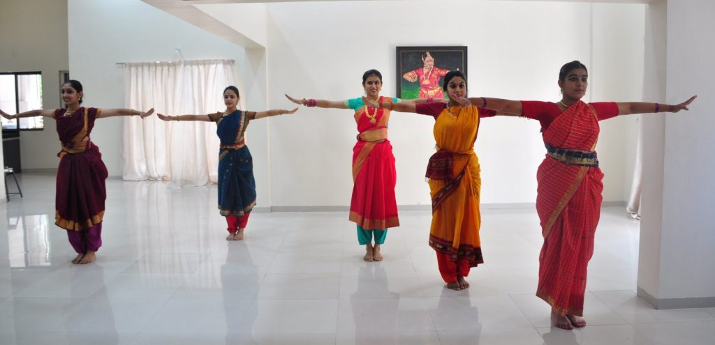 Five girls in practice costumes with their hands in naatyarambham position