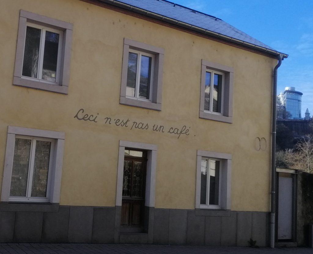 A building which says 'Ceci n'est pas un cafe.