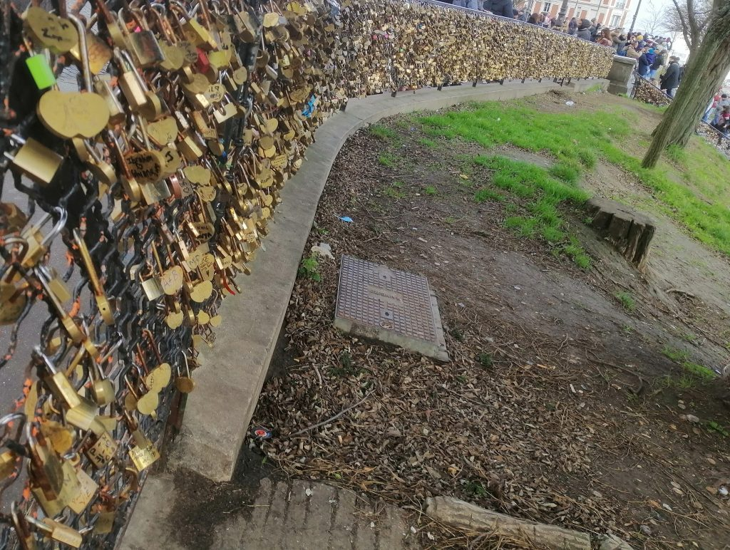Thousands of golden locks on a curving fence