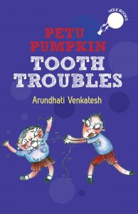 book cover Text: Petu Pumpkin Tooth Troubles Hole books Arundhati Venkatesh Image: Illustration of one child using a string to pull out another child's tooth