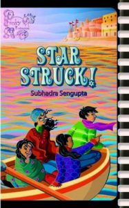Book cover Text: Star Struck! Subhadra Sengupta A Foxy 4 Adventure Image: Four children in a boat looking at something one girl is pointing at