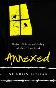 Book cover Text: The incredible story of the boy who loved Anne Frank Annexed Sharon Dogar Image: Two silhouetted birds on a bare tree visible through a window. Everything else is black, with barbed wire highlighting the writer's name.